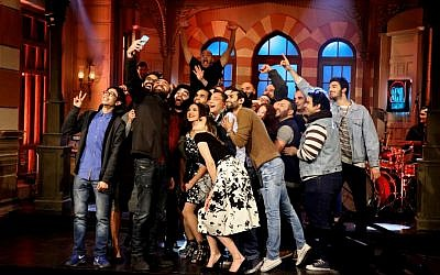 "This Tuesday, Feb. 16, 2016 photo provided by OSN, shows actors taking a 'selfie' at the end of OSN's ""Saturday Night Live Arabia,"" show in Cairo, Egypt.  (OSN via AP)"
