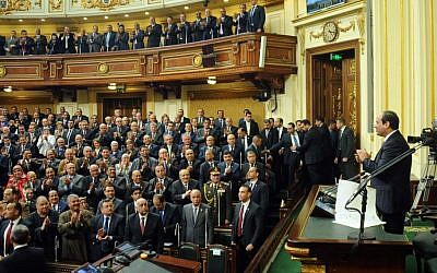 In this photo provided by Egypt's state news agency MENA, Egyptian President Abdel-Fattah el-Sissi, addresses parliament in Cairo, Egypt, February 13, 2016. (MENA via AP)