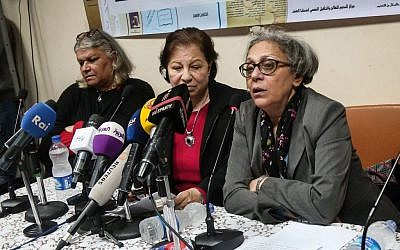 Aida Seif el-Dawla , Suzan Fayyad, center, and Magda Adly, right, co-founder of El Nadeem Center for Rehabilitation of Victims of Violence, hold a press conference in Cairo, Sunday, Feb. 21, 2016. Activists at El Nadeem Egypt's top institution providing rehabilitation and psychotherapy to people who survivors of torture and abuse, including sexual violence, say the government's plan to shut them down will not stop their work in documenting and publishing torture committed by the state. (AP Photo/Mohamed el Raai)