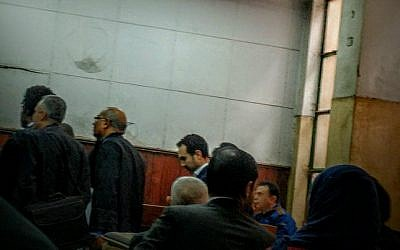 Egyptian author Ahmed Naji, center background, attends a court hearing in Cairo, Egypt, Saturday, Feb. 20, 2016. (AP Photo/Ramy Yaacoub)