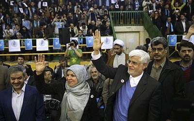 Head of the reformists' coalition list of the Iranian parliamentary elections Mohammad Reza Aref (right) accompanied by his wife, Hamideh, arrive at a campaign rally in Tehran, Iran, February 18, 2016. (AP/Vahid Salemi)