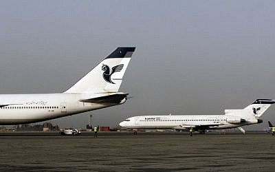 In this Sunday, March 2, 2008 photo, two passenger planes of Iran's national air carrier, Iran Air, are parked at the Mehrabad Airport in Tehran, Iran. (AP Photo/Vahid Salemi)