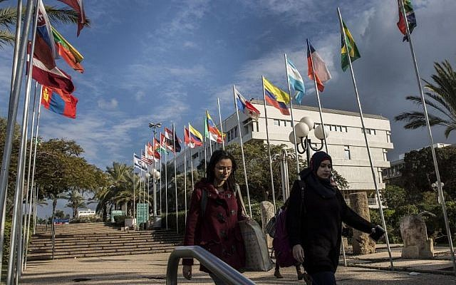 Students walk through the Tel Aviv University campus in Israel. (AP Photo/Tsafrir Abayov)