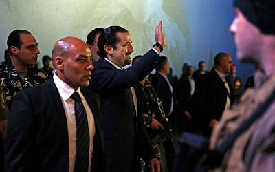 Former Lebanese Prime Minister Saad Hariri, waves as he arrives to a ceremony to mark the 11th anniversary of the assassination of his father, former Prime Minister Rafik Hariri, in Beirut, Lebanon, Sunday, Feb. 14, 2016. (AP Photo/Hassan Ammar)