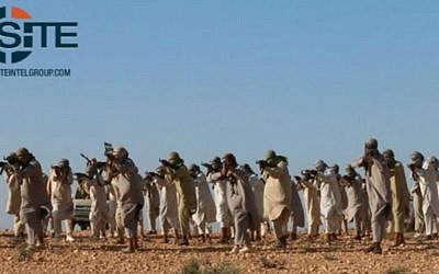 This image posted online February 5, 2016 by supporters of the Tripoli Province of the Islamic State (IS) in Libya on a social media site and vetted by SITE Intel Group shows fighters training at a jihadist camp in Libya. (Militant photo via AP)