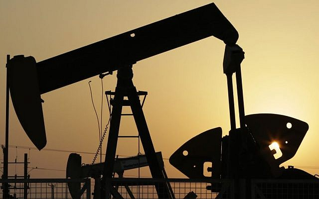 In this Sept. 30, 2015, file photo, oil pumps work in the desert oil fields of Sakhir, Bahrain. (AP Photo/Hasan Jamali, File)