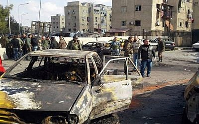 Illustrative: Soldiers and plainclothes policemen gather at the scene of an explosion that killed tens of people and wounded others in the Syrian capital of Damascus on Tuesday Feb. 9, 2016 (SANA via AP)