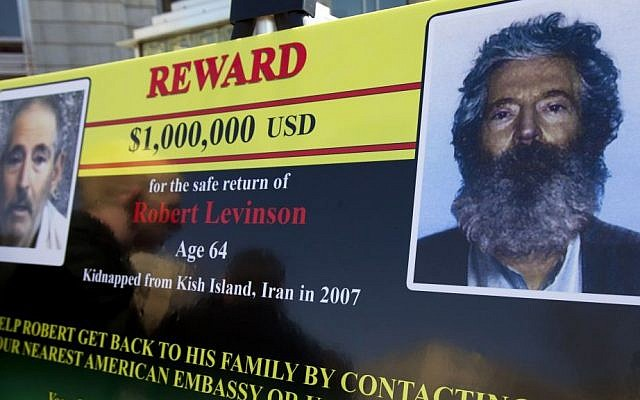 An FBI poster shown in Washington during a news conference shows a composite image of former FBI agent Robert Levinson, right, of how he would look like now, and a photo from a video released by his captors in 2010, left, March 6, 2012. (AP Photo/ Manuel Balce Ceneta, File)
