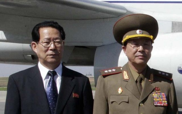 Deputy minister Foreign Affairs Kim Hyong Jun  (left)  and Ri Yong Gil, col. gen. of the Korean People's Army, pose before leaving Pyongyang Airport in North Korea for China, May 22, 2013. (AP Photo/Kim Kwang Hyon)
