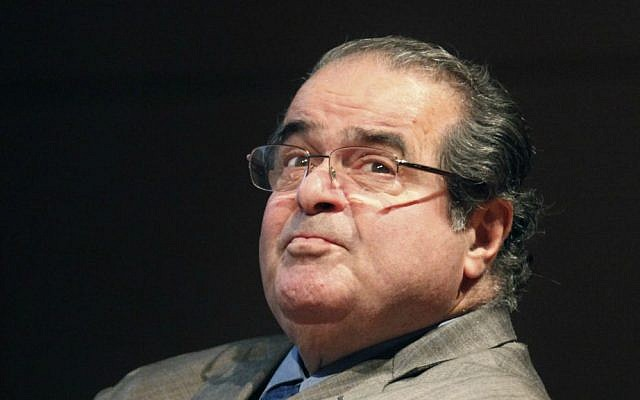 In this October 18, 2011 file photo, US Supreme Court justice Antonin Scalia looks into the balcony before addressing the Chicago-Kent College of Law in Chicago. (AP Photo/Charles Rex Arbogast, File)