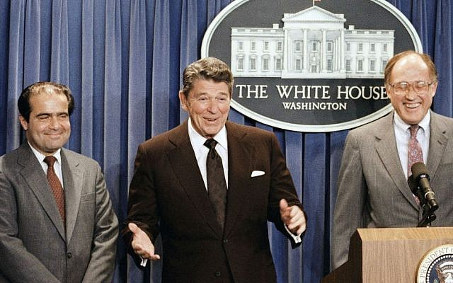 In this June 17, 1986 file photo, President Ronald Reagan speaks at a news briefing at the White House in Washington, where he announced the nomination of Antonin Scalia, left, to the Supreme Court as a result of Chief Justice Warren E. Burger's resignation. William Rehnquist is at right. (AP Photo/Ron Edmonds)