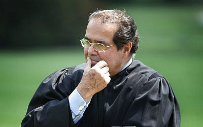 Supreme Court Justice Antonin Scalia listens to President Bush speaking during a swearing-in ceremony on the South Lawn of the White House in Washington, DC, June 7, 2006. (AP/Ron Edmonds, File)