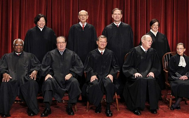 In this Oct. 8, 2010 file photo, the Supreme Court justices pose for a group photo at the Supreme Court in Washington. Seated, from left are, Clarence Thomas, Antonin Scalia, Chief Justice John Roberts, Anthony Kennedy, and Ruth Bader Ginsburg. Standing, from left are Sonia Sotomayor, Stephen Breyer, Samuel Alito Jr. and Elena Kagan. (AP Photo/Pablo Martinez Monsivais, File)