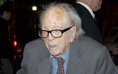 """In this Nov. 13, 2011 file photo, British cinematographer Douglas Slocombe arrives for a tribute to Oscar-winning actress Vanessa Redgrave in London. Slocombe, who filmed the Nazi invasion of Poland, the adventures of """"Indiana Jones"""" and the madcap farce of Ealing comedies, died Monday, Feb. 22, 2016, in a London hospital. He was 103. (AP Photo/Joel Ryan, File)"""