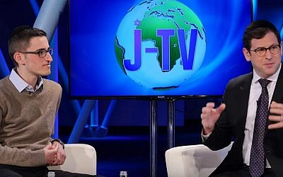 Oliver Anisfeld (left) on the Jewish Wisdom segment on the newly launched J-TV in discussion with Rabbi Shlomo Farhi. (YouTube screenshot)