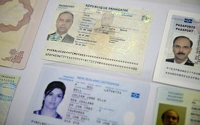 "Fake passports are displayed at the immigration bureau in Bangkok on February 10, 2016 after Thai police broke up a major fake passport ring led by an Iranian known as ""The Doctor"". (NICOLAS ASFOURI / AFP)"