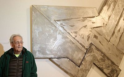 US artist Frank Stella poses in front of one of his works at an exhibition devoted to him in Warsaw, Poland, Thursday, February 18, 2016 (AP Photo/Czarek Sokolowski)