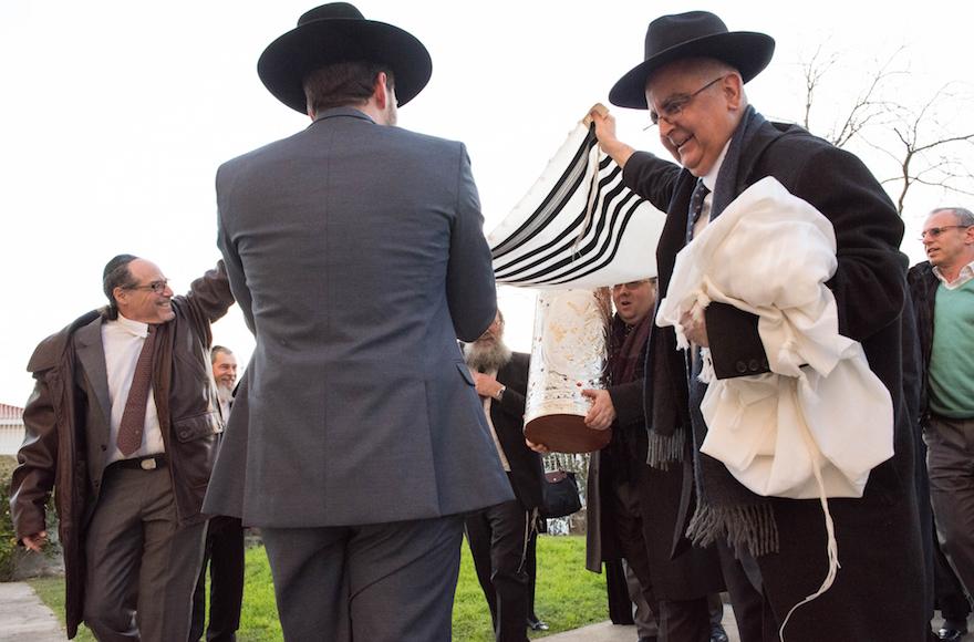 Congregants carrying a Torah scroll into the Kadoorie – Mekor Haim synagogue in Porto, Portugal, Jan. 29, 2016 (Cnaan Liphshiz/JTA)