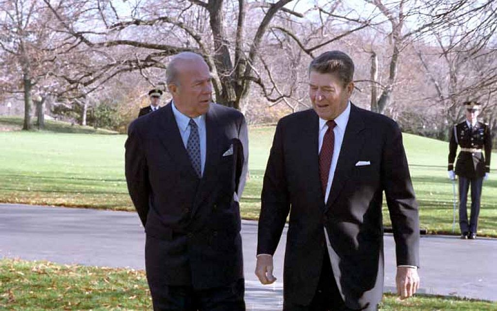 President Ronald Reagan walking with Secretary of State George Shultz outside of the Oval Office, December 4, 1986 (Ronald Reagan Presidential Library)