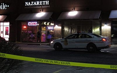 Police talk inside the Columbus, Ohio, restaurant where they say a man attacked several people with a machete on Thursday, February 11, 2016. (AP/Kantele Franko)