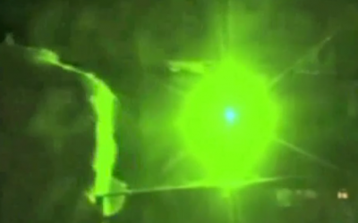 Illustrative: Laser beam attack on a plane (CNN screenshot)