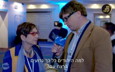 A fake foreign journalist asks an Israeli woman, 'Why are the Jews so bad at genocide?' during a segment for the comedic television show, 'Hayom ba'Lila with Guri Alfi,' which pokes fun at the perceived hatred of the foreign media towards Israel on February 21, 2016. (Screen capture)