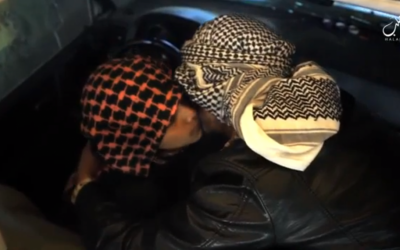 The father of an Islamic State teen suicide bomber kisses his son before sending him off. (screen capture: VideoPress)