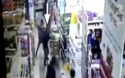 Security camera footage from a deadly stabbing at a West Bank Rami Levy supermarket on February 18, 2016. (screen capture: Channel 2)