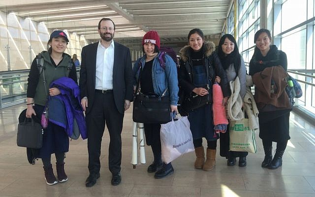 Shavei Israel Founder and Chairman Michael Freund, second from left, greets five women from Kaifeng, China after they arrived at Ben Gurion Airport, Israel, February 29, 2016. (Laura Ben-David/Courtesy of Shavei Israel)