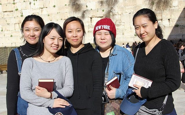From left to right: Li Yuan, Yue Ting, Li Jing, Li Chengjin and Gao Yichen standing in front of the Western Wall, in the Old City of Jerusalem, February 29, 2016. (Laura Ben-David/Courtesy of Shavei Israel)