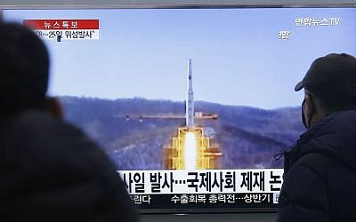 South Koreans watch a TV news program with file footage of North Korea's rocket launch plans, at Seoul Railway Station in Seoul, South Korea, Wednesday, Feb. 3, 2016. (AP Photo/Ahn Young-joon)