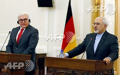 Iran's Foreign Minister Mohammad Javad Zarif (R) holds a press conference with his German counterpart, Frank-Walter Steinmeier, on February 2, 2016, in Tehran.