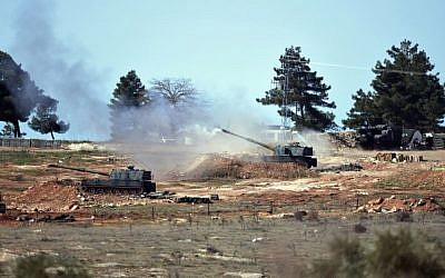 Turkish artillery fire from the border toward northern Syria, in Kilis, Turkey on Feb. 16, 2016. (AP Photo/Halit Onur Sandal)