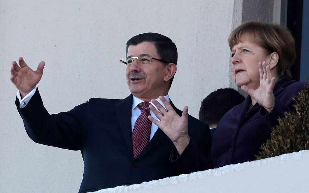 German Chancellor Angela Merkel, right, and Turkish Prime Minister Ahmet Davutoglu speak as they look toward the city center after a welcome ceremony in Ankara, Turkey, Monday, February 8, 2016. (AP/Burhan Ozbilici)