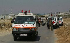 Illustrative: International Red Cross members securing transport for sick Palestinians from Gaza into Israel for medical treatment at the Erez Crossing on June 19, 2007. (Ahmad Khateib/ Flash90)