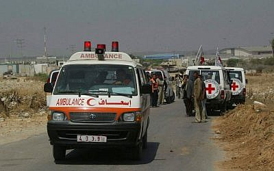 International Red Cross members securing transport for sick Palestinians from Gaza into Israel for medical treatment at the Erez Crossing on June 19, 2007. (Ahmad Khateib/ Flash90)