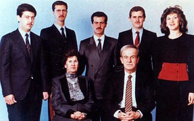 The Assad family in a photo taken at un unknown date. Hafez Assad and his wife, Aniseh Makhlouf are seated in front. behind them, from left to right: Maher, Bashar, Bassel, Majd, and Bushra Assad. (Public Domain