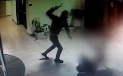 Security camera footage showing Palestinian Saadi Ali Abu Ahmad attacking unarmed security guard Tzvi Cohen with an ax, in a mall in the settlement of Ma'ale Adumim, February 25, 2016. (YouTube/Alik Maor)
