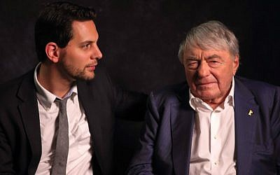 Filmmaker Adam Benzine, left, and acclaimed documentarian Claude Lanzmann in 2013. (Jet Black Iris America via JTA)