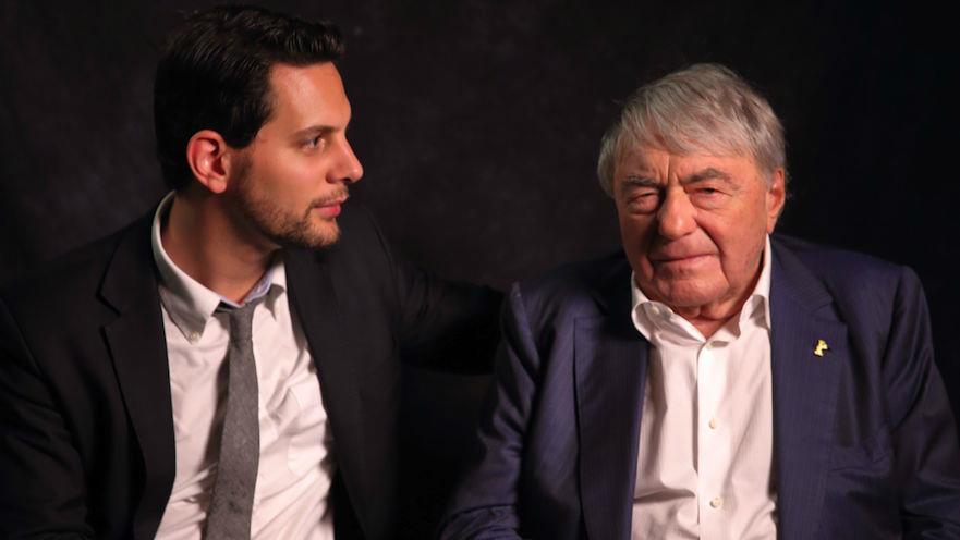 Filmmaker Adam Benzine, left, and acclaimed documentarian Claude Lanzmann in 2013. (Jet Black Iris America via JTA)