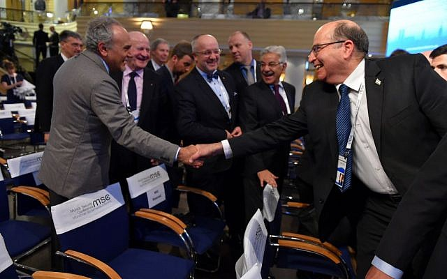Defense Minister Moshe Ya'alon (R) shakes hands with Saudi Prince Turki al-Faisal at the Munich Security Conference on February 14, 2016 (Ariel Harmoni/Defense Ministry)