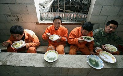 Illustrative: Chinese foreign workers excavating tunnels in the Carmel in northern Israel take a break to have lunch. February 24, 2009. (Moshe Shai/Flash90)