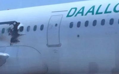A hole caused by an explosion is seen in the fuselage of a Daallo Airlines plane on February 2, 2016 (YouTube screen capture)