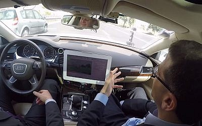 Former US ambassador to Israel Dan Shapiro takes a ride in Israeli MobilEye's self-driving car (YouTube screen capture)