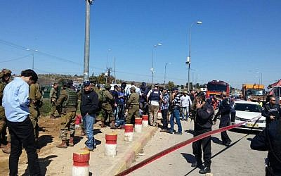 Army and rescue forces at the scene of a stabbing attack at the Etzion Junction in the West Bank on Wednesday, February 24, 2016. (Israel Fire and Rescue Services)
