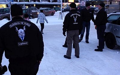 A group of men calling themselves the 'Soldiers of Odin, a' Finnish group claiming to protect locals from asylum seekers, February 5, 2016. (AFP/Sam Kingsley)