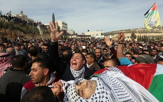 Palestinian mourners carry the body of Amjad Abu Omar Sakari, who was shot dead while carrying out an attack on Israeli soldiers near the Beit El settlement, during his funeral in the village of Jamain south of Nablus, February 1, 2016. (AFP/Jaafar Ashtiyeh)