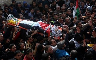 Palestinian mourners carry the body of Amjad Abu Omar Sakari, who was shot dead while carrying out an attack on Israeli soldiers near the Beit El settlement, during his funeral in the village of Jamain south of Nablus, on February 1, 2016. (AFP / JAAFAR ASHTIYEH)