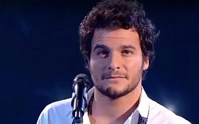 Amir Haddad performs on the French version of reality singing show The Voice in 2014 (screen capture: YouTube)