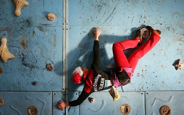 In this Monday, Jan. 18, 2016 photo, Iranian rock climber, Farnaz Esmaeilzadeh, scales a climbing gym in the city of Zanjan, some 330 kilometers (207 miles) west of the capital Tehran, Iran. (AP Photo/Ebrahim Noroozi)